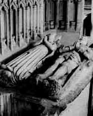 Effigies in the chancel lie under the remains of the partially destroyed chantry.
